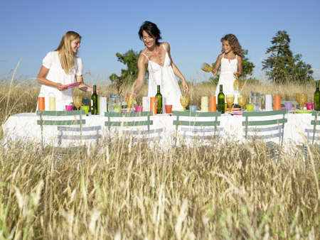 easygoing: Girls setting the table, outdoors