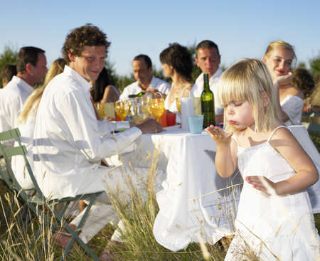 simple girl: People having dinner in a field LANG_EVOIMAGES