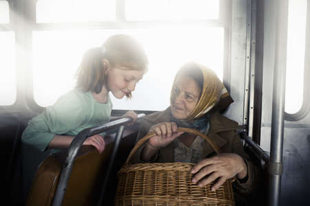motorcoach: Old Woman with a young girl