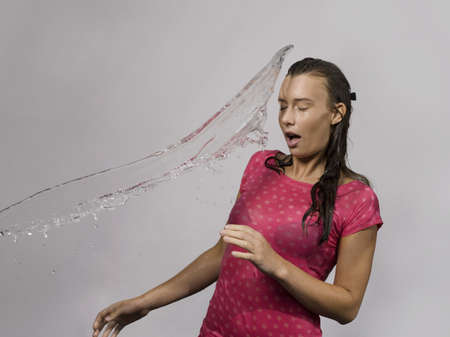 saturating: Woman splashed with water LANG_EVOIMAGES