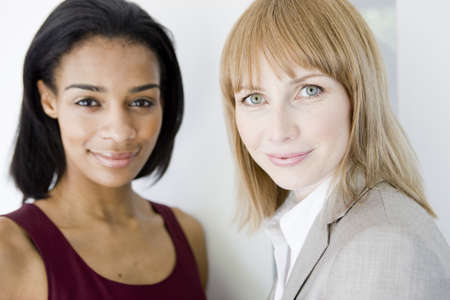 north western european descent: 2 businesswomen looking at viewer LANG_EVOIMAGES