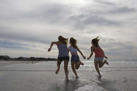 Teenage Girls running on Beach