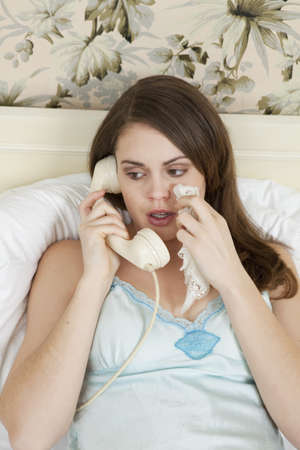 young woman on the phone, crying