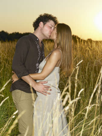 cherished: Couple kissing,  in a field