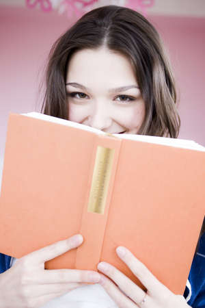 abodes: Girl looking at viewer with book