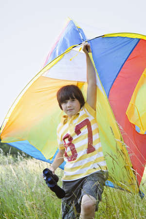 arms lifted up: Boy With Kite and Binoculars LANG_EVOIMAGES