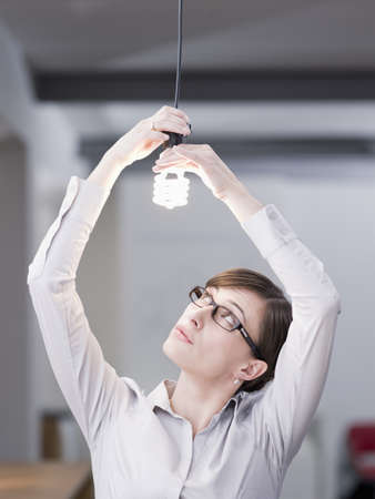 Woman looking at a lamp
