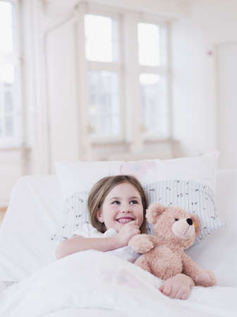 dependencies: girl in bed with teddy bear