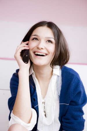 abodes: Girl using phone laughing