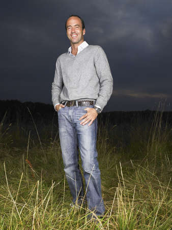Man standing in a field,  by night LANG_EVOIMAGES