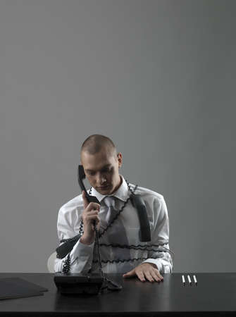 struggled: Businessman talking in phone LANG_EVOIMAGES