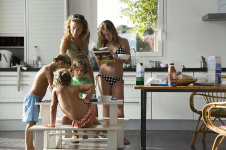Mom with kids eating breakfast