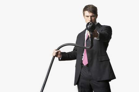 Man aiming petrol pump LANG_EVOIMAGES