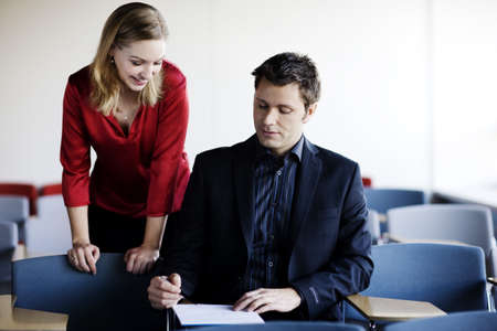 interrogations: Man and woman working on a file LANG_EVOIMAGES