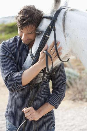 man holding horse LANG_EVOIMAGES
