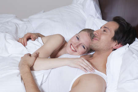 cherished: couple in bed, laughing