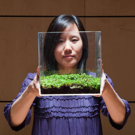women's issues: Woman observing green plant