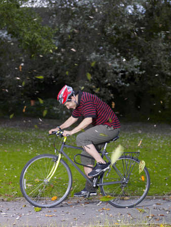 survives: Man cycling in wind