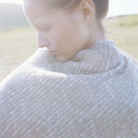 musing: Woman looking thoughtfully in warm sun LANG_EVOIMAGES