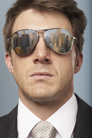 insights: Business man with sunglasses on LANG_EVOIMAGES