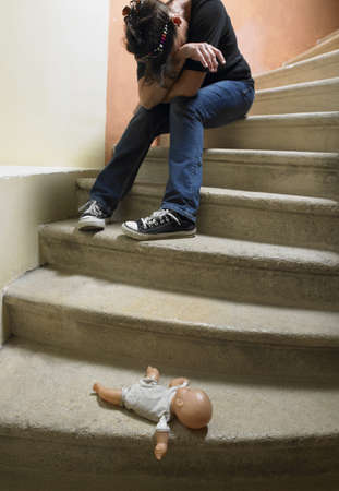cried: Doll on the stairs,  sad woman