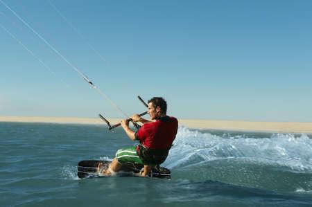 Man kitesurfing near beach