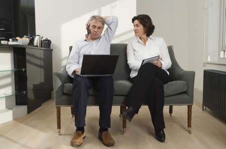 acknowledging: Mature couple working from home