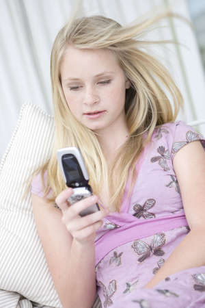 responded: Teenage Girl using mobile phone LANG_EVOIMAGES