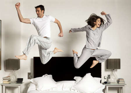 rushed: couple leaping out of bed