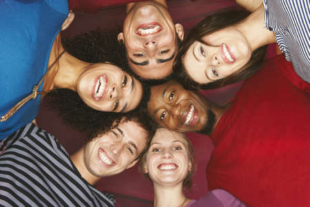 english ethnicity: Young group of friends,  heads together