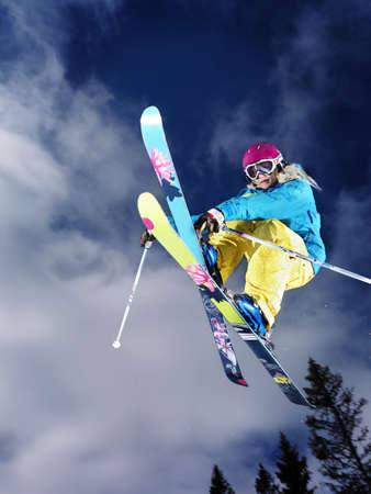 feats: Girl doing a grab mid air.