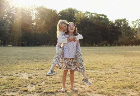 light duty: Girl getting piggyback from sister
