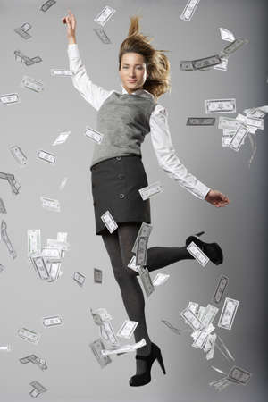 indebted: Woman jumping with bank notes