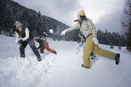 Teenagers in a snowball fight