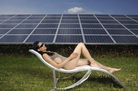 lavishly: woman sunbathing in front of solar panel