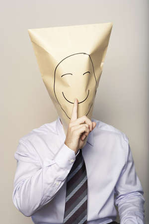 Business man with paper bag on head
