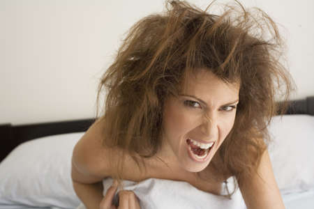 woman snarling playfully in bed