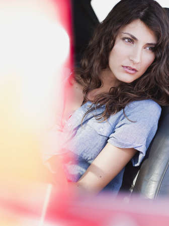 woman sitting in front seat of car LANG_EVOIMAGES