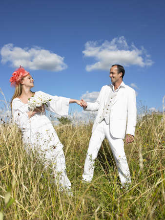 Married couple in a field LANG_EVOIMAGES