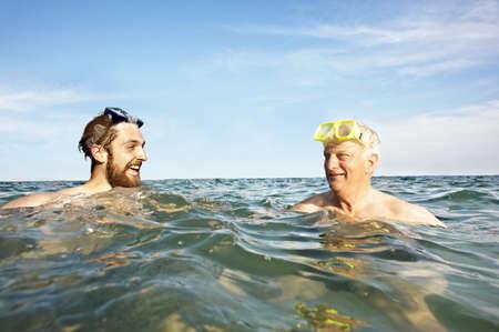talker: Portrait of two men swimming in sea