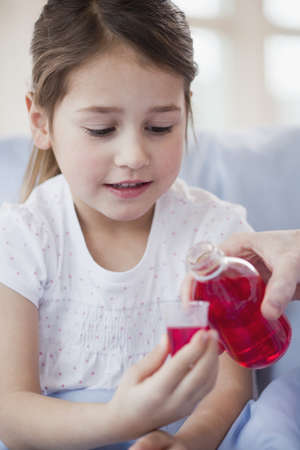 girl receiving medicine