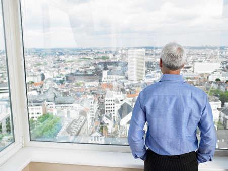 musing: Business Man looking through window