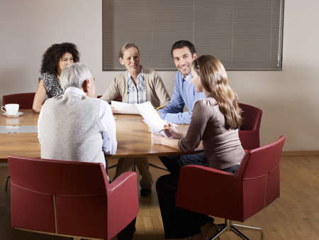reviews: Group of people at boardroom table