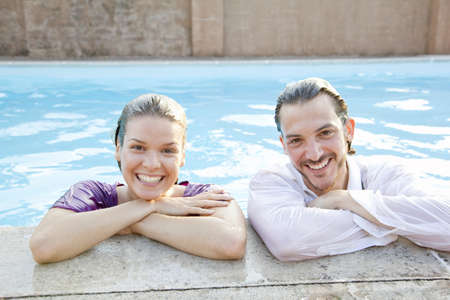 couple in pool,dressed