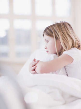 sickly: girl in bed looking out of the window