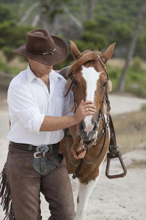 fondling: man padding horse