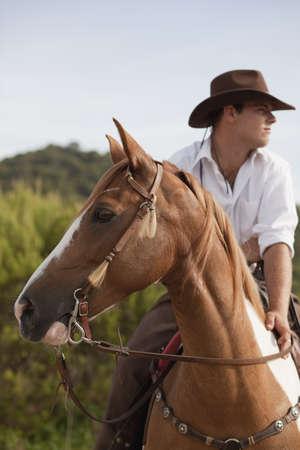 man riding horse LANG_EVOIMAGES