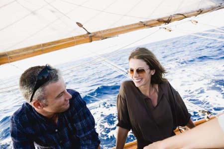 lavishly: couple on a sailing boat