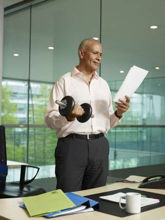 reviews: A man exercises in his office