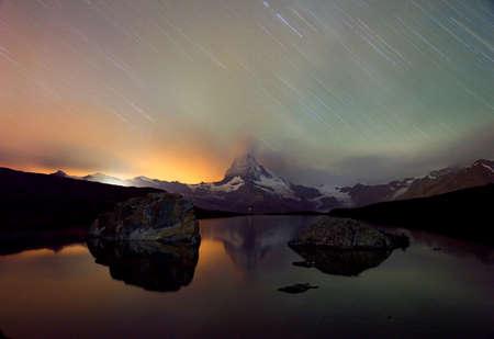 stormy waters: Matterhorn, lake, thunderstorm at night